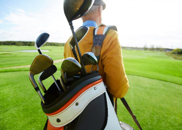 carrying-golf-clubs-46RHJCK-min